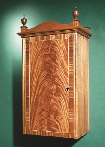 Federal Wall Cabinet in honduran mahogany and crotch mahogany veneer, with maple inlaid Isoloc Mirror Key joinery. 34H x 18W x 11D