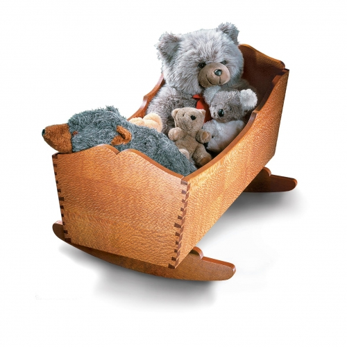 Rocking Cradle in lacewood with single angle, decorative cogged dovetails. 22H x 24W x 35D