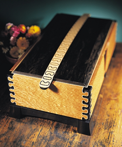 Storage Box in lacewood with maple inlay and corners and top in ebony. Featuring inlaid Mirror Key pattern. 7H x 18W x 10D
