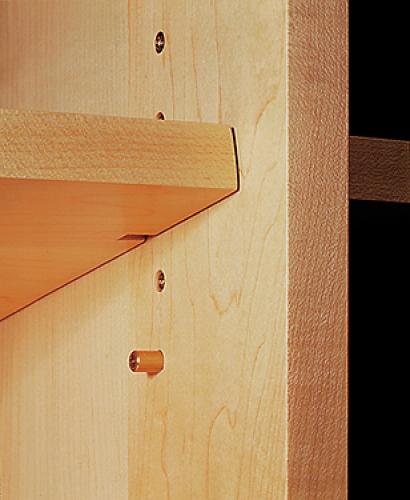 Adjustable shelving with notched shelf perfectly aligned with shelf hole.