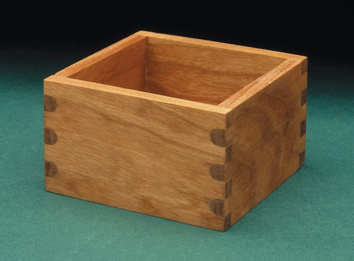 Box with rounded finger joints on one face and square finger joints on adjacent face.