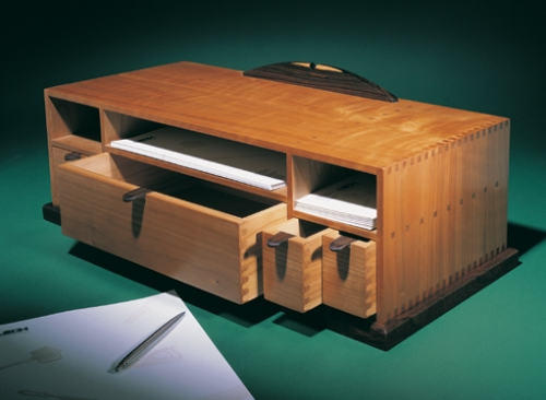 Desk Organizer in cherry with cocobolo accents. Featuring 14 square and 14 rounded finger joints, and mortise and tenons made on the F1. 8H x 23W x 10D
