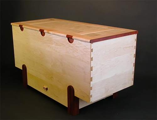 Toy Box in North American and Fiddle Back Maple with accents of Paduak. Half Blind dovetails. Malcolm Harwood.